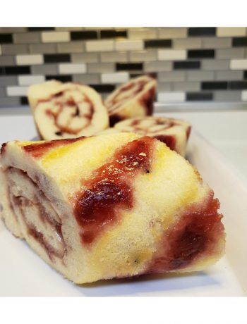 Cherry & Blueberry Pancake Rolls on a kitchen counter.