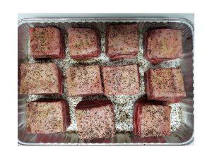 Caveman short ribs in a tray.