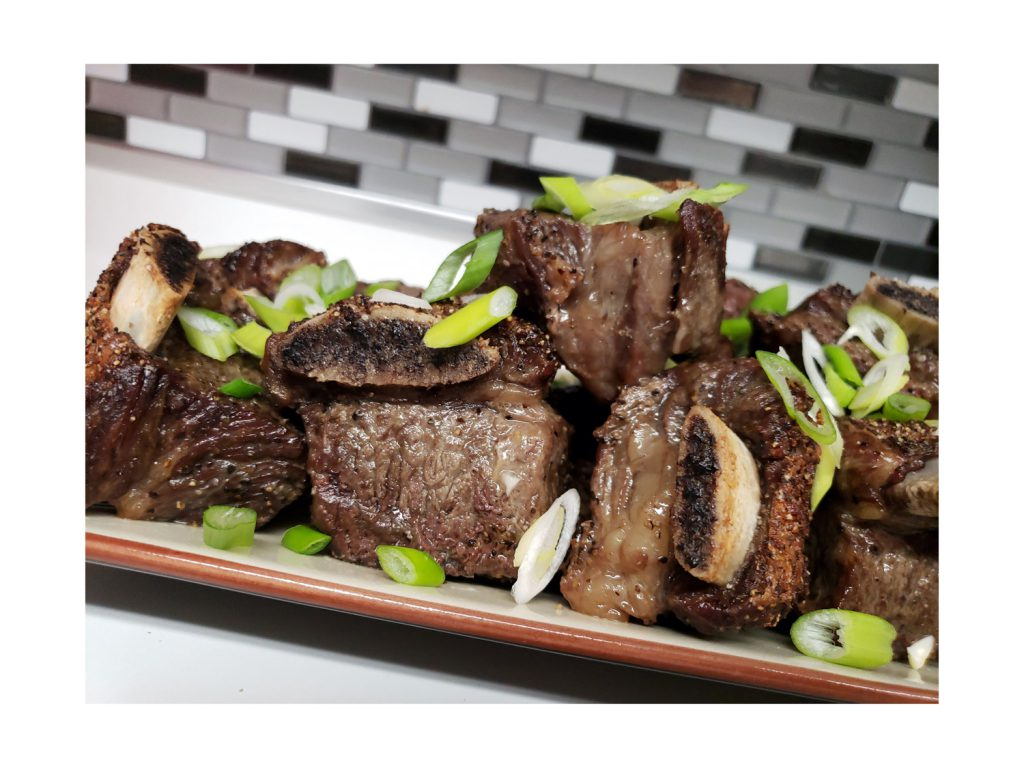 Caveman Short Ribs Served with Green Onions