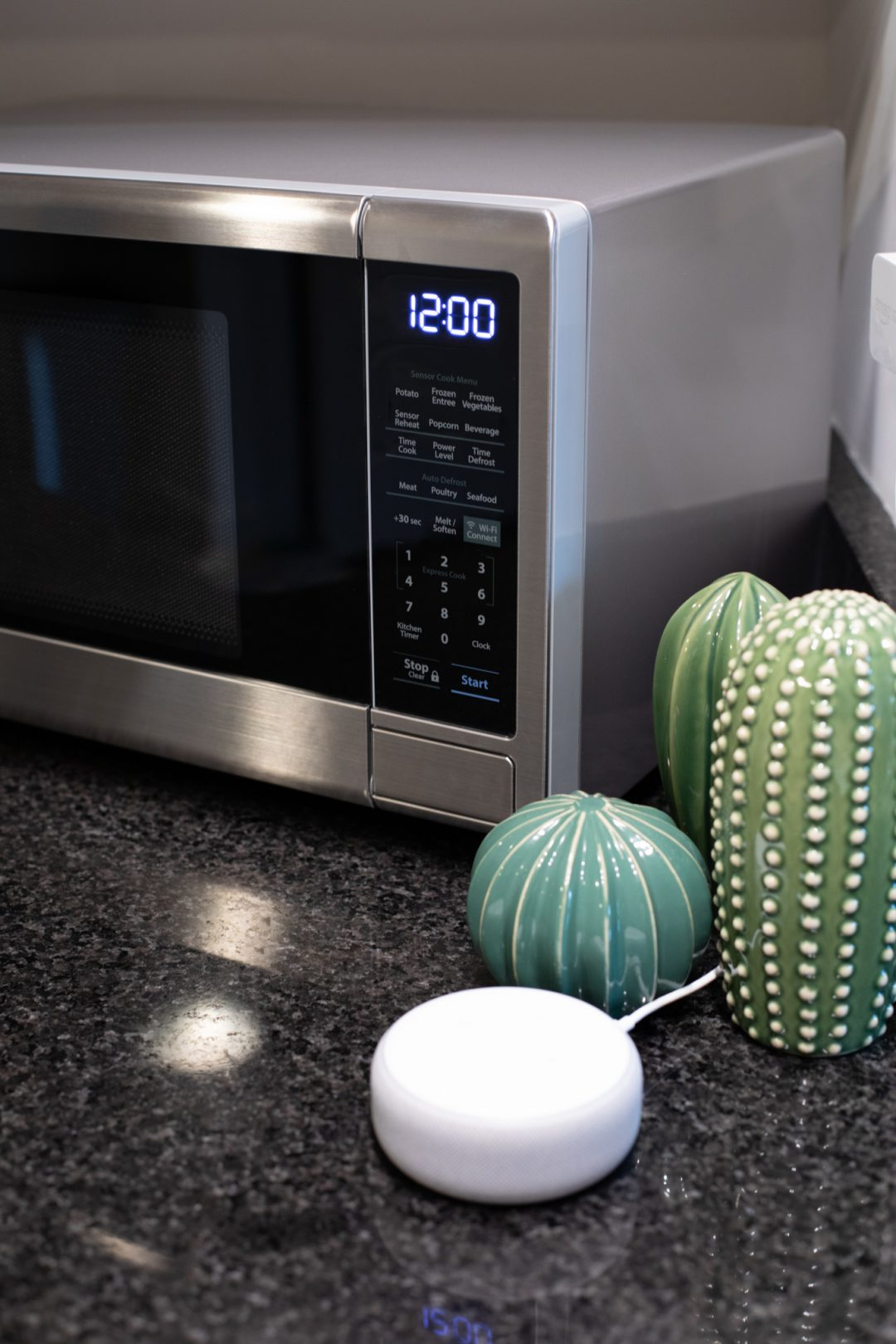Sharp Smart countertop microwave oven on a kitchen countertop with an Amazon Echo