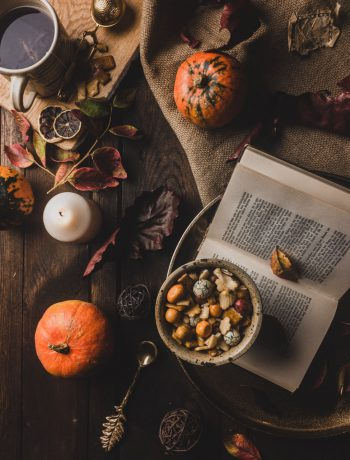 book with pumpkins and other fall decorations
