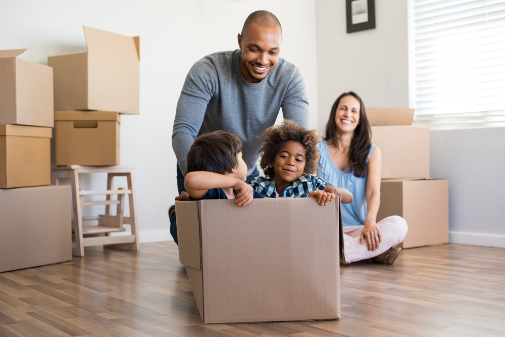 family moving boxes into a new home