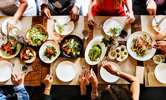 Eight people gathered around a dinner table.