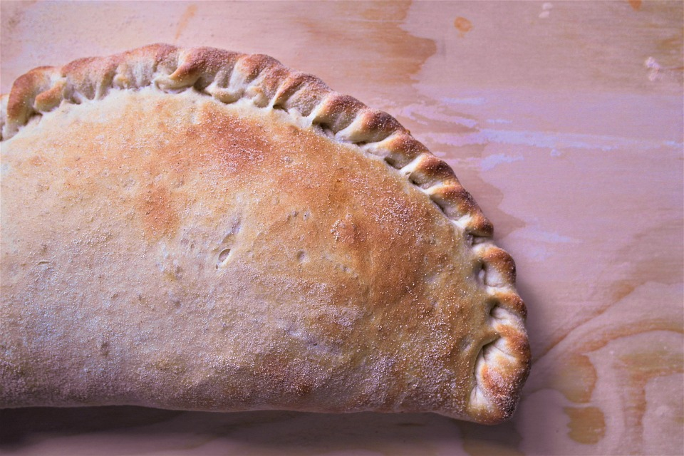 Calzone on a wooden surface.