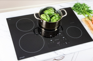 vegetables boiling in a pot on an induction cooktop