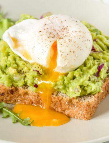 Breakfast egg dish on a blue cloth.