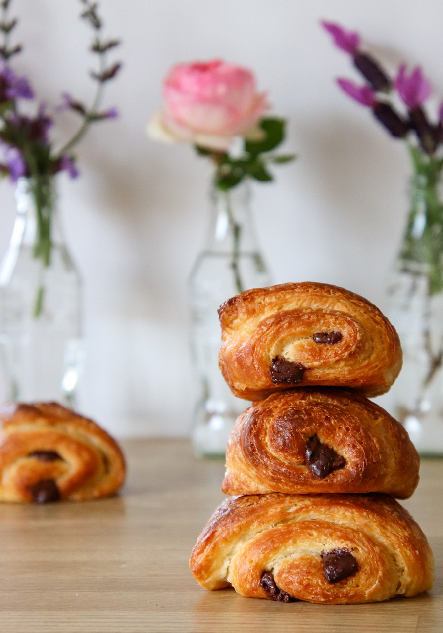 stack of pain au chocolat pastries on a table