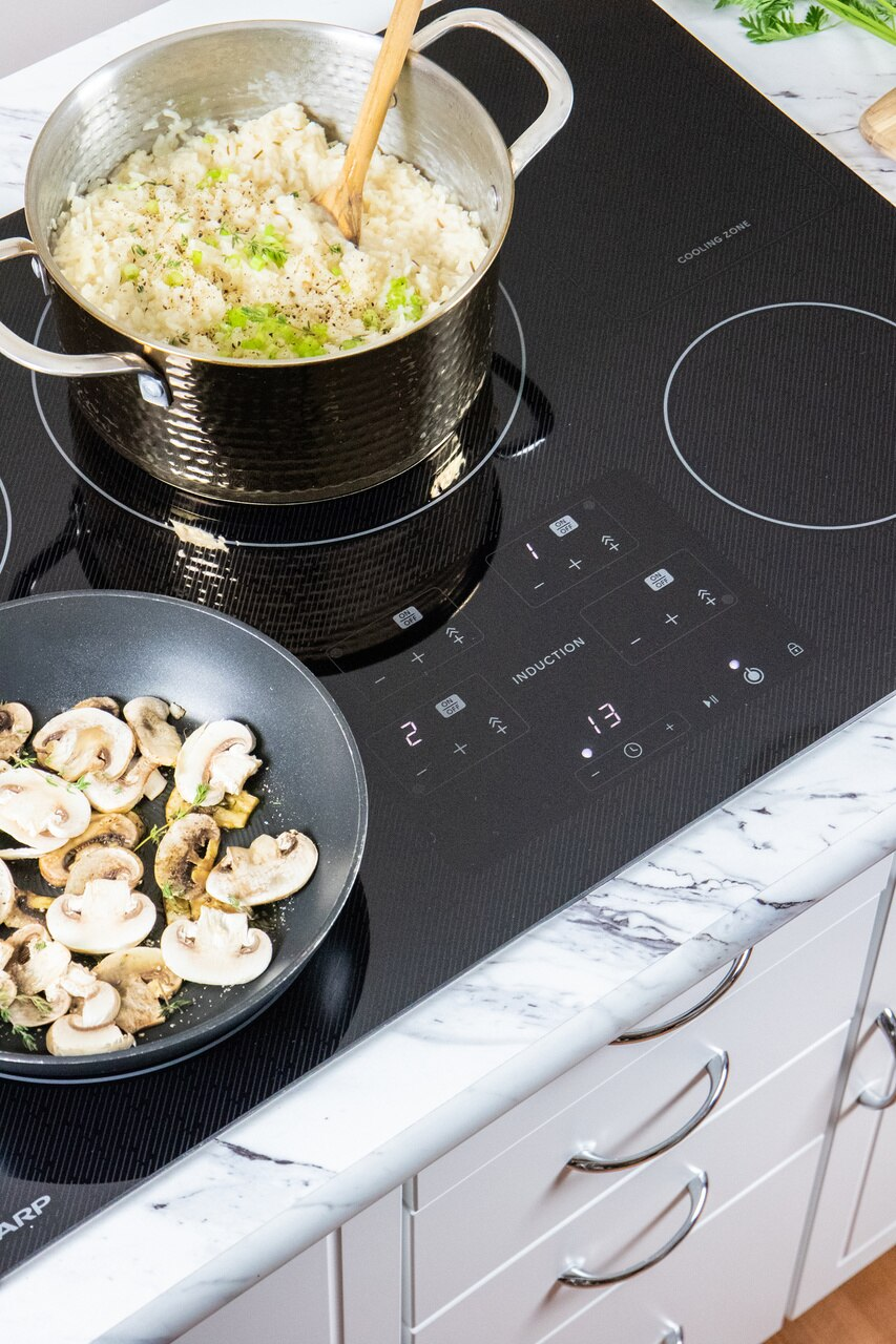 "30-Inch Black Induction Cooktop (SDH3042DB) – preparing a meal on the Sharp 30"" induction cooktop"