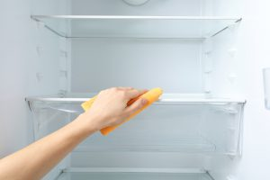 Wiping down your fridge. - Spruce Up Your Kitchen This Spring
