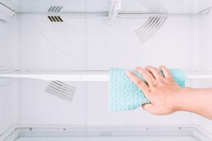 Cleaning the inside of a refrigerator. - Spruce Up Your Kitchen This Spring