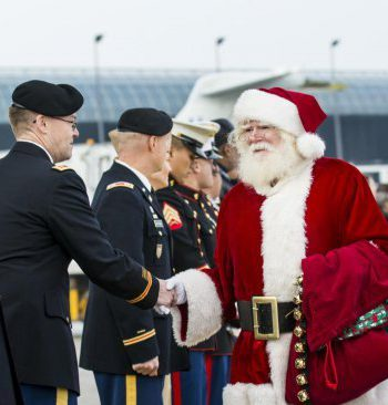 Santa shaking hands with military personnel