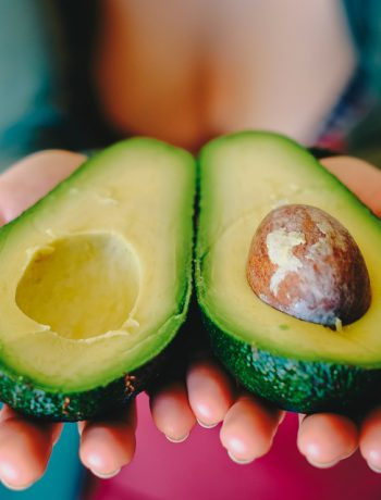 An avocado in a woman's hand