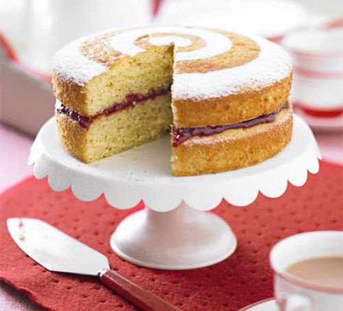 Sponge Cake with raspberry on a cake tray
