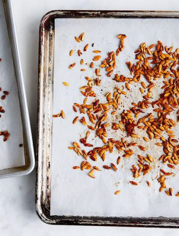 Chopped up nuts on a sheet pan