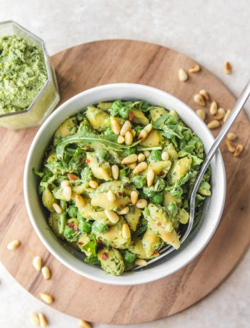 Pea Pesto Pasta in a bowl on a wooden surface