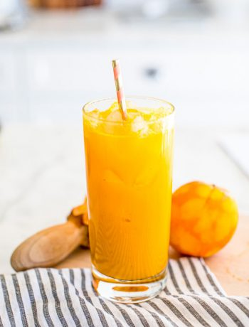 Anti-Inflammatory Tumeric Tonic in Orange Juice glass