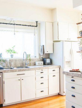 White kitchen design with modern appliances