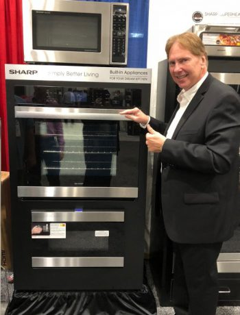 Peter Weedfald next to Sharp Home Appliances