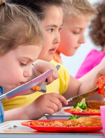 Children eating school lunches.