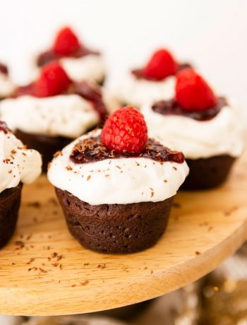Chocolate cupcakes with rasberries.