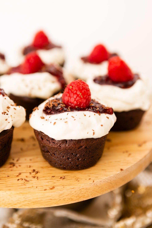 Chocolate cupcakes with rasberries.