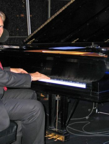 Peter Weedfald playing a grand piano