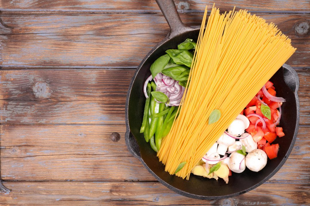 Spaghetti and vegetables in a pan