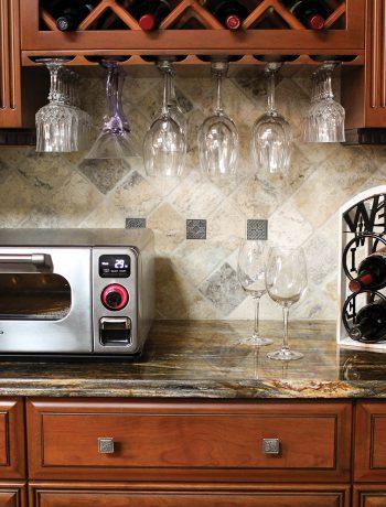 Wine rack in kitchen next to Sharp Supersteam Countertop Microwave