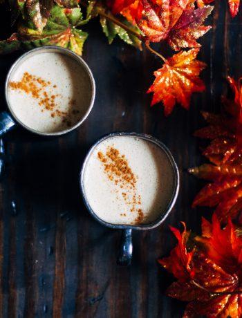 Two espressos next to fall decor.