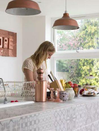 Woman preparing a meal in a modern kitchen design.