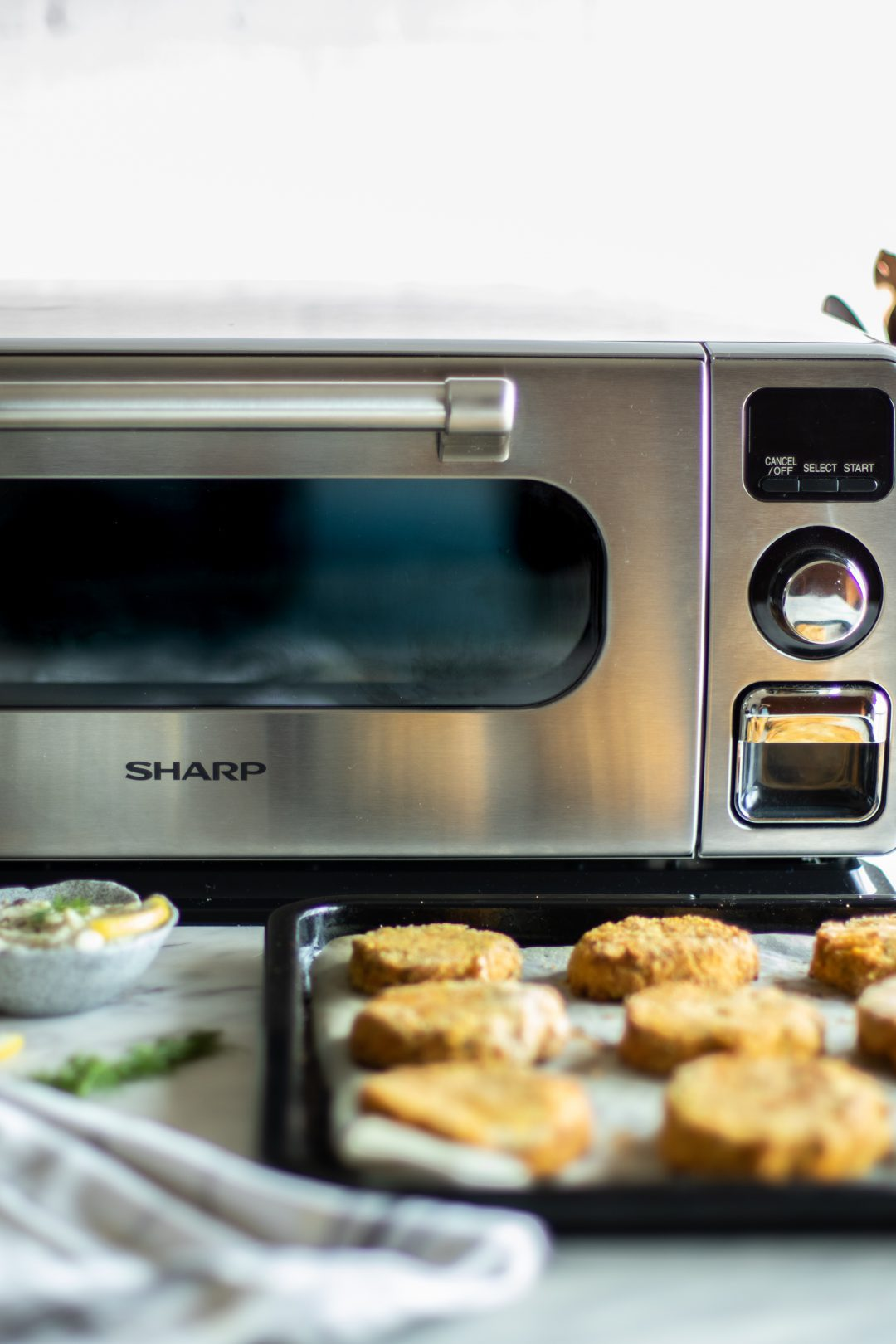 Salmon Sweet Potato Croquettes next to Sharp Superheated Steam Countertop Oven