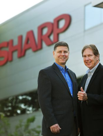 Jim Sanduski and Peter Weedfald outside of Sharp Electronics headquarters.