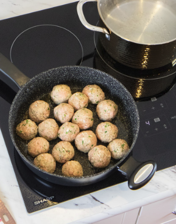 Turkish meatballs being prepared on a Sharp Induction Cooktop.