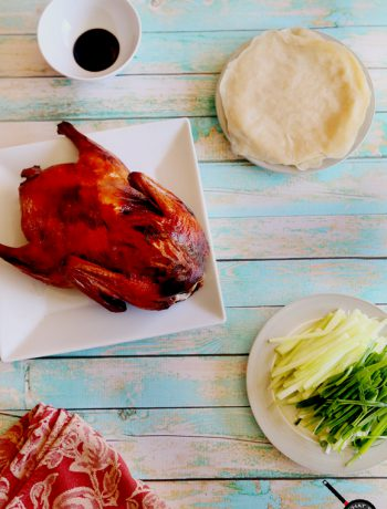 Peking Duck and ingredients on a table.