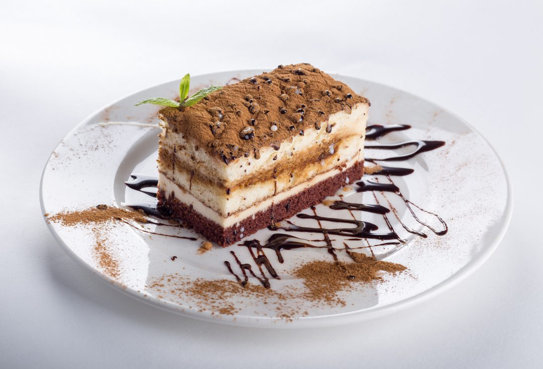 Dairy-free cake with chocolate on a plate.