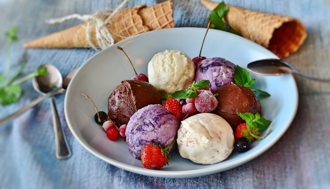 Ice cream plate with an array of fruits.