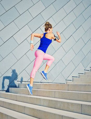 Woman jogging along steps.
