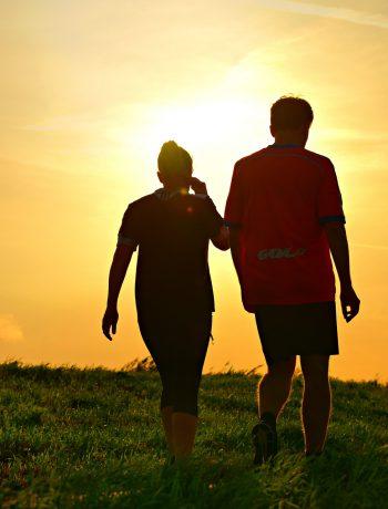 A couple taking a walk near sunset.