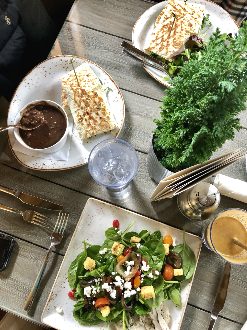 Salad and nutritional foods among a table setting.