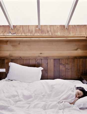 A woman sleeping in a bed.