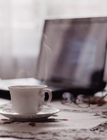 A coffee setting with laptop.