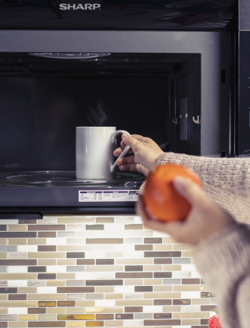 Sharp microwave with coffee.