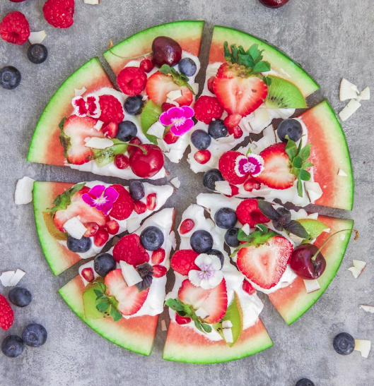 Watermelon creation with strawberries.