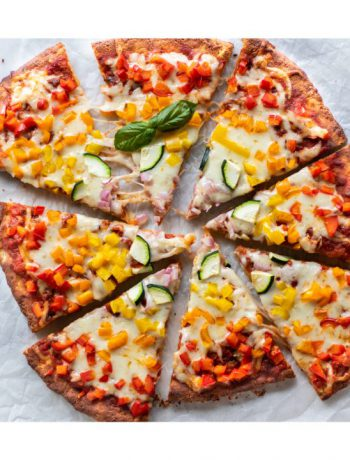 Rainbow pizza cut up.