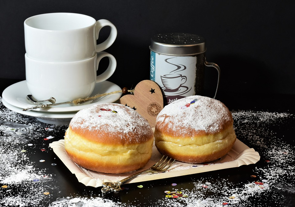 Two pastries with powdered sugar