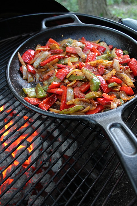 Cast iron with vegetables on a grille.