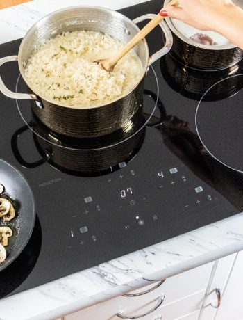 Rice cooking in a pot on an induction cooktop.