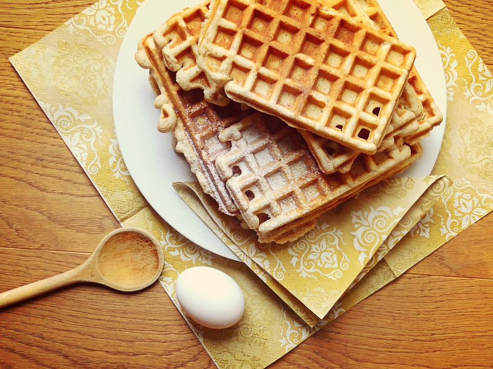 Waffles stacked upon one another on a table.