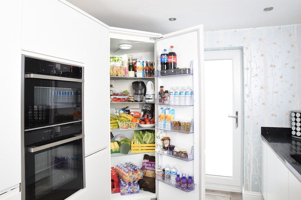 Stacked pantry in a modern kitchen design.