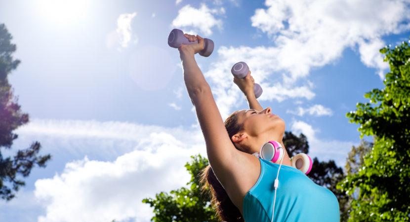 A woman exercising outdoors.